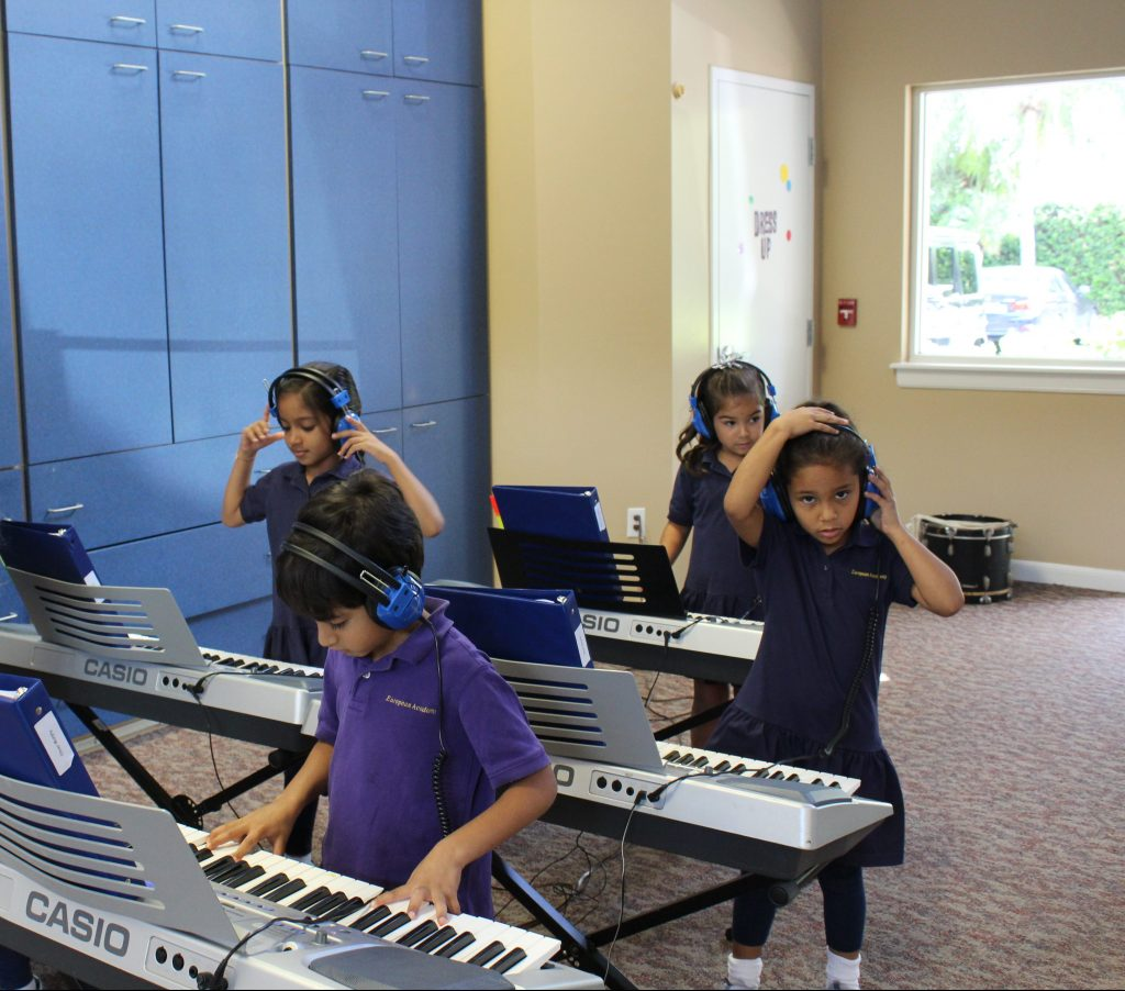 EEAE students using pianos image