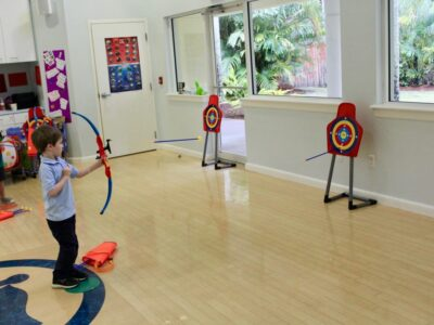 EEAE students using toy bow and arrows image