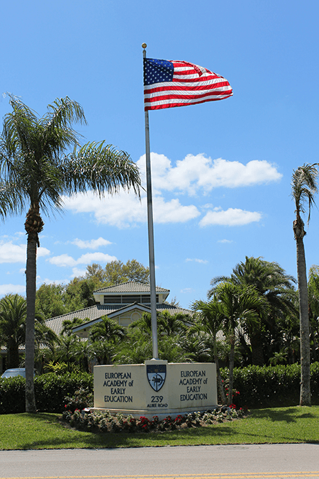 EEAE entrance sign with american flag image