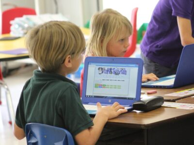 EEAE students using laptops for schoolwork image