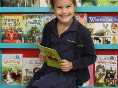 EEAE student reading book image