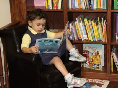 EEAE student reading book image