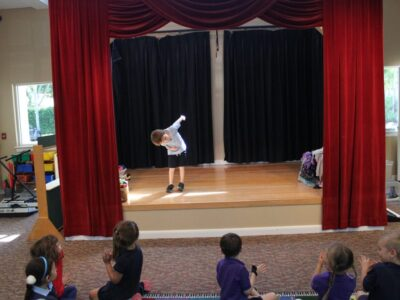 Child bowing on small stage image